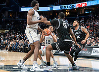 WASHINGTON, DC - FEBRUARY 19: Kalif Young #13 and Luwane Pipkins #12 of Providence surround Terrell Allen #12 of Georgetown during a game between Providence and Georgetown at Capital One Arena on February 19, 2020 in Washington, DC.