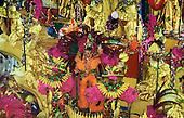 Rio de Janeiro, Brazil. Carnival; Imperatriz samba school procession with gold, purple and orange banana theme.