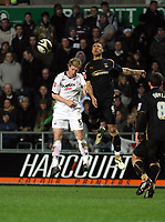 Pictured L-R: Alan Tate of Swansea City against Leon Best.<br /> Re: Coca Cola Championship, Swansea City FC v Coventry City at the Liberty Stadium. Swansea, south Wales, Friday 26 December 2008.<br /> Picture by D Legakis Photography / Athena Picture Agency, Swansea 07815441513