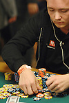 Lasse Melby stacks his chip after winning a big pot.