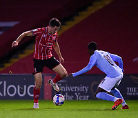 Lincoln City's Tom Hopper vies for possession with Manchester City U21's Claudio Gomes<br /> <br /> Photographer Andrew Vaughan/CameraSport<br /> <br /> EFL Papa John's Trophy - Northern Section - Group E - Lincoln City v Manchester City U21 - Tuesday 17th November 2020 - LNER Stadium - Lincoln<br />  <br /> World Copyright © 2020 CameraSport. All rights reserved. 43 Linden Ave. Countesthorpe. Leicester. England. LE8 5PG - Tel: +44 (0) 116 277 4147 - admin@camerasport.com - www.camerasport.com