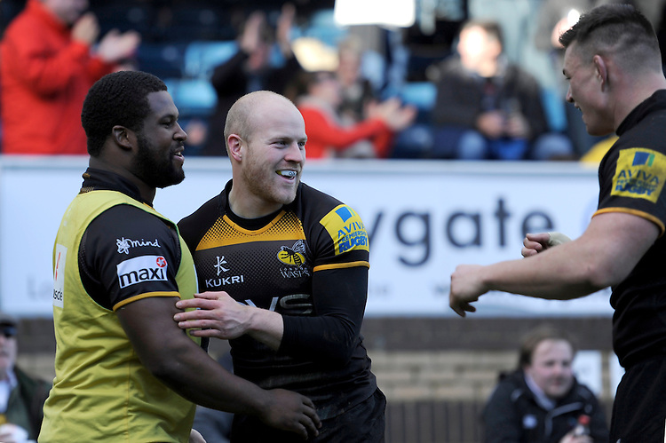 Joe Simpson of London Wasps celebrates scoring a try with Simon McIntyre of London Wasps during the Aviva Premiership match between London Wasps and Sale Sharks at Adams Park on Saturday 1st March 2014 (Photo by Rob Munro)