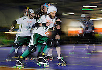 15 MAR 2014 - BIRMINGHAM, GBR - Abnorman of Ireland passes Real Axt of Germany during their bout at the inaugural Men's Roller Derby World Cup in the Futsal Arena in Birmingham, West Midlands, Great Britain (PHOTO COPYRIGHT © 2014 NIGEL FARROW, ALL RIGHTS RESERVED)