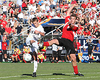 Scott Caldwell #15 of the University of Akron blasts a shot at Colin Rolfe #9 of the University of Louisville during the 2010 College Cup final at Harder Stadium, on December 12 2010, in Santa Barbara, California. Akron champions, 1-0.