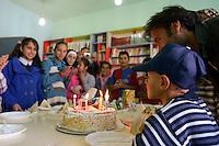 LEBANON Deir el Ahmad, a maronite christian village in Beqaa valley, school for syrian refugee children / LIBANON Deir el Ahmad, ein christlich maronitisches Dorf in der Bekaa Ebene, Schule der Good Shepherds Sisters der maronitischen Kirche fuer syrische Fluechtlingskinder, Junge Ahmad feiert seinen 11. Geburtstag, er ist mit seiner Familie aus Homs geflohen