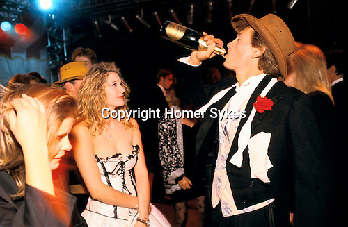 DRINKING CHAMPAGNE FROM THE BOTTLE AT THE CIRENCESTER BALL 1990,