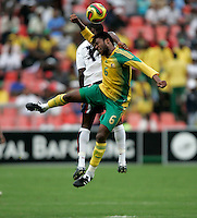 USA's Jozy Altidore and South Africa's Macbeth Sibaya during second half action between the national teams of South Africa (RSA) and the United States (USA) in an international friendly dubbed the Nelson Mandela Challenge at Ellis Park Stadium in Johannesburg, South Africa on November 17, 2007. The United States defeated South Africa 1-0.