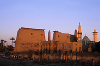 Tourists visiting the Luxor Temple at sunset, Luxor, Egypt.