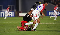 Egypt's Salah Soliman (2) attempts to get back on his feet after failing to makes a goal from a corner kick against Costa Rica's Cristian Gamboa (12) during the FIFA Under 20 World Cup Round of 16 match between Egypt and Costa Rica at the Cairo International Stadium on October 06, 2009 in Cairo, Egypt.