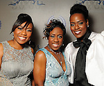 From left: Sisters Tina Egans, Irishea Hilliard and Preashea Hilliard at a gala celebrating 50 years of ministry for Bishop I.V. Hilliard at the New Light Christian Church August 31,2012.(Dave Rossman/For the Chronicle)