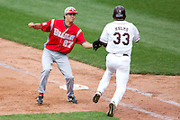 Jerrod Eigsti (27) of the Bradley Braves tags out Spiker Helms (33) of the Missouri State Bears during a game against the Missouri State Bears on May 13, 2011 at Hammons Field in Springfield, Missouri.  Photo By David Welker/Four Seam Images