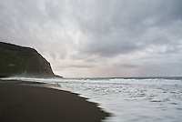 Blur motion image of Waipio Beach with sea mist (ehukai) in the background