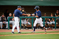 Elizabethton Twins second baseman Michael Helman (13) is congratulated by Jeff Reed (1) as he rounds third base after hitting a home run in the bottom of the sixth inning during a game against the Bristol Pirates on July 29, 2018 at Joe O'Brien Field in Elizabethton, Tennessee.  Bristol defeated Elizabethton 7-4.  (Mike Janes/Four Seam Images)
