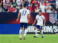 NASHVILLE, TN - SEPTEMBER 5: Tyler Adams #4 of the United States passes the ball during a game between Canada and USMNT at Nissan Stadium on September 5, 2021 in Nashville, Tennessee.
