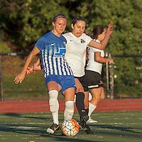 Peabody, Massachusetts - June 22, 2016:  In a Women's Premier Soccer League (WPSL) match, Boston Aztec (white) vs Boston Breakers Reserves (blue), at Bishop Fenwick High School.