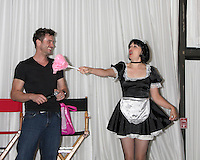 LOS ANGELES - AUG 27:  Daniel Goddard with Singing Telegram Actress getting Birthday Greetings from Fans that hired her attending the Daniel Goddard Fan Event 2011 at the Universal Sheraton Hotel on August 27, 2011 in Los Angeles, CA