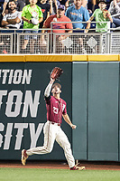 Florida State Seminoles outfielder Albert Reese (23) makes a catch during Game 9 of the NCAA College World Series against the Texas Tech Red Raiders on June 19, 2019 at TD Ameritrade Park in Omaha, Nebraska. Texas Tech defeated Florida State State 4-1. (Andrew Woolley/Four Seam Images)