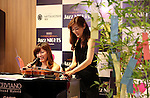 July 1, 2016, Tokyo, Japan - Japanese violinist Junko Makiyama (R) and pianist Riyoko Takagi smile at an interval of their jazz session at the Mitsukoshi department store in Tokyo's Ginza district on Friday, July 1, 2016. Their public recording of FM broadcasting will be on air on July 24.  (Photo by Yoshio Tsunoda/AFLO) LWX -ytd-