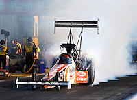 Sep 27, 2013; Madison, IL, USA; NHRA top fuel dragster driver Clay Millican during qualifying for the Midwest Nationals at Gateway Motorsports Park. Mandatory Credit: Mark J. Rebilas-
