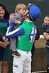 HOT SPRINGS, AR - JANUARY 16: Channing Hill being congratulated by his son Wayllen after winning the the Smarty Jones Stakes at Oaklawn Park on January 16, 2017 in Hot Springs, Arkansas. (Photo by Justin Manning/Elipse Sportwire/Getty Images)