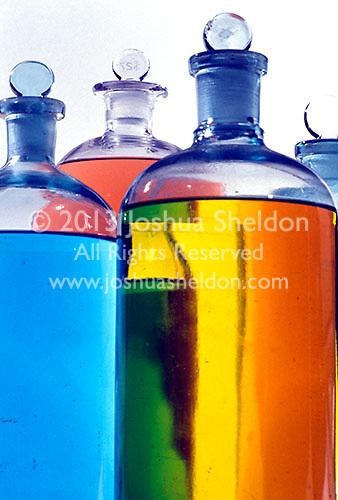 Coloured liquids in glass bottles<br />