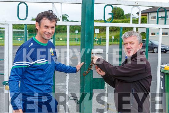 Killarney Legion Chairman Fergal Moynihan and Pat Moynihan reopen the gates of the GAA club on Friday