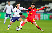 SWANSEA, WALES - NOVEMBER 12: Sergino Dest #2 of the United States battles with Josh Sheehan #21 of Wales during a game between Wales and USMNT at Liberty Stadium on November 12, 2020 in Swansea, Wales.