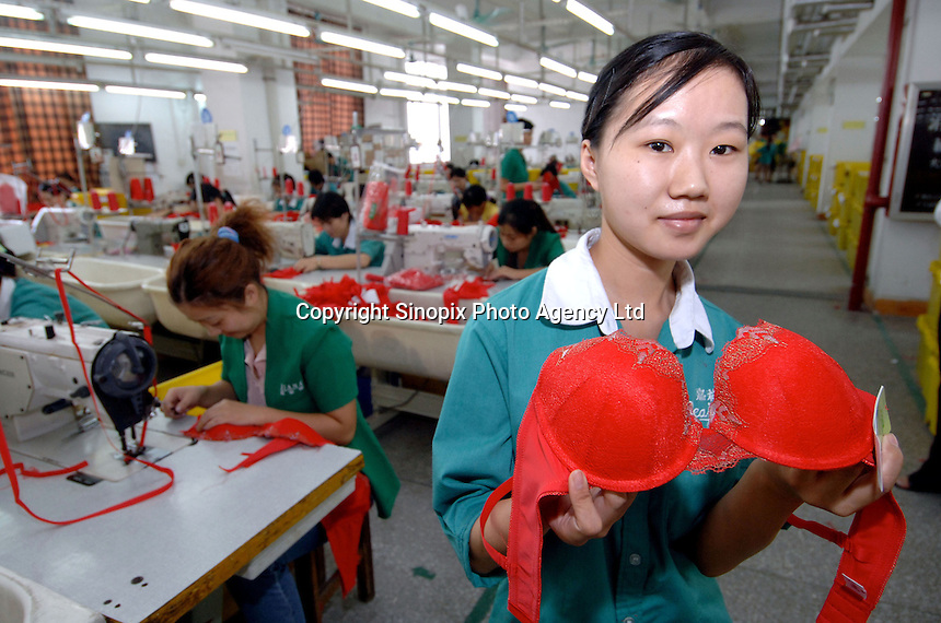 Ai Fang Shu, 20,  has spent more than a year in the Jealousy factory at the International Underwear City, Yanbu Town, Nanhai District, Foshan City, Guangdong, China.  Jealousy produces 11 million bras annually and is increasing production by about 20 percent annually...PHOTO BY SINOPIX