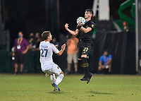 LAKE BUENA VISTA, FL - JULY 18: Tristan Blackmon 27 of LAFC receives a pass off his chest while pressured by Emil Cuello #27 of LA Galaxy during a game between Los Angeles Galaxy and Los Angeles FC at ESPN Wide World of Sports on July 18, 2020 in Lake Buena Vista, Florida.
