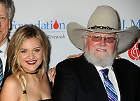 06 July 2020 - Country music and southern rock legend Charlie Daniels has passed away after suffering a stroke. The Grand Ole Opry member and Country Music Hall of Famer was 83. File Photo: 27 February 2017 - Nashville, Tennessee - Kelsea Ballerini and Charlie Daniels. T.J. Martell Foundation 9th Annual Nashville Honors Gala  held at the Omni Hotel. Photo Credit: Laura Farr/AdMedia