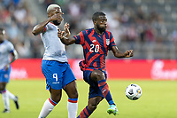 KANSAS CITY, KS - JULY 11: Shaq Moore #20 of the United States passes the ball during a game between Haiti and USMNT at Children's Mercy Park on July 11, 2021 in Kansas City, Kansas.