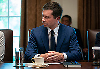 United States Secretary of Transportation Pete Buttigieg, listens during a cabinet meeting with U.S. President Joe Biden at the White House in Washington, D.C., U.S., on Tuesday, July 20, 2021. Biden administration officials say they're starting to see signs of relief for the global semiconductor supply shortage, including commitments from manufacturers to make more automotive-grade chips for car companies. <br /> Credit: Al Drago / Pool via CNP /MediaPunch