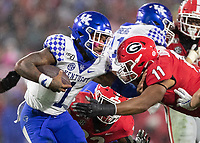 ATHENS, GA - OCTOBER 19: Lynn Bowden Jr. #1 of the Kentucky Wildcats is tackled by Jermaine Johnson #11 of the Georgia Bulldogs during a game between University of Kentucky Wildcats and University of Georgia Bulldogs at Sanford Stadium on October 19, 2019 in Athens, Georgia.