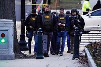 Authorities walk toward the U.S. Capitol on Wednesday, Jan. 6, 2021, in Washington. (AP Photo/Jacquelyn Martin)