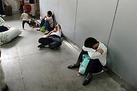 CHINA. Beijing. Passengers waiting inside Beijing West Train Station. 2007.