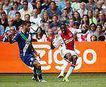 Nederland, Amsterdam, 17 juli 2015<br /> Oefenwedstrijd<br /> Ajax-VFL Wolfsburg<br /> Queensy Menig van Ajax zet de bal voor