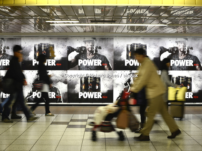 Arnold Schwarzenegger and Bruce Willis appear to Kowa's Power Coffee advert in Shinjuku, Tokyo
