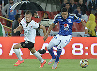 BOGOTA - COLOMBIA -26 -07-2015: Kevin Rendon (Der) jugador de Millonarios disputa el balón con Freddy Salazar (Izq) jugador de Once Caldas durante partido por la fecha 3 de la Liga Águila II 2015 jugado en el estadio Nemesio Camacho El Campín de la ciudad de Bogotá./ Kevin Rendon (R) player of Millonarios fights for the ball with Freddy Salazar (L) player of Once Caldas during the match for the third date of the Aguila League II 2015 played at Nemesio Camacho El Campin stadium in Bogotá city. Photo: VizzorImage / Gabriel Aponte / Staff.