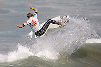 American Kolohe Andino with a front side reo during round of 48 at the 2010 US Open of Surfing in Huntington Beach, California on August 5, 2010.