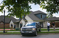A coroner departs, Thursday, June 3, 2021 from the site of a fatal house fire at 3211 SW Riverstone Ave. in Bentonville.  Check out nwaonline.com/210604Daily/ for today's photo gallery. <br /> (NWA Democrat-Gazette/Charlie Kaijo)