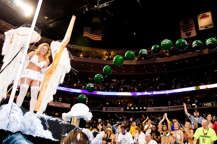 """At the 14th annual Wing Bowl, held in Philadelphia on February 3, 2006 at the Wachovia Center.<br /> <br /> The Wing Bowl is a competitive eating event in which eaters try and down the most hot wings in 30 total minutes in front of a crowd of 10,000 plus people.  The real show however is all around the eaters, from the various scantily clad women (known as """"Wingettes"""") that make up eaters' entourages, to the behavior of the fans themselves."""