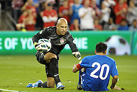 U.S goalkeeper Tim Howard helps up Carlos Ruiz (20) Guatemala..USMNT defeated Guatemala 3-1 in World Cup qualifying play at LIVESTRONG Sporting Park, Kansas City, KS.