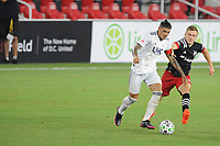 WASHINGTON, DC - AUGUST 25: Gustavo Bou #7 of New England Revolution battles for the ball with Julian Gressel #31 of D.C. United during a game between New England Revolution and D.C. United at Audi Field on August 25, 2020 in Washington, DC.