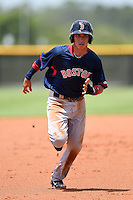 GCL Red Sox shortstop Javier Guerra (12) running the bases during a game against the GCL Rays on June 24, 2014 at Charlotte Sports Park in Port Charlotte, Florida.  GCL Red Sox defeated the GCL Rays 5-3.  (Mike Janes/Four Seam Images)