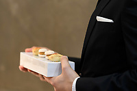 Modena, 23 February 2017 – Waiters carry out amuse bouch during a lunch service at Osteria Francescana, Modena, Italy. Photo Sydney Low
