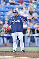 Asheville Tourists manager Robinson Cancel discusses a call during a game against the Greensboro Grasshoppers  at McCormick Field on May 10, 2018 in Asheville, North Carolina. The Tourists defeated the Grasshoppers 9-3. (Tony Farlow/Four Seam Images)
