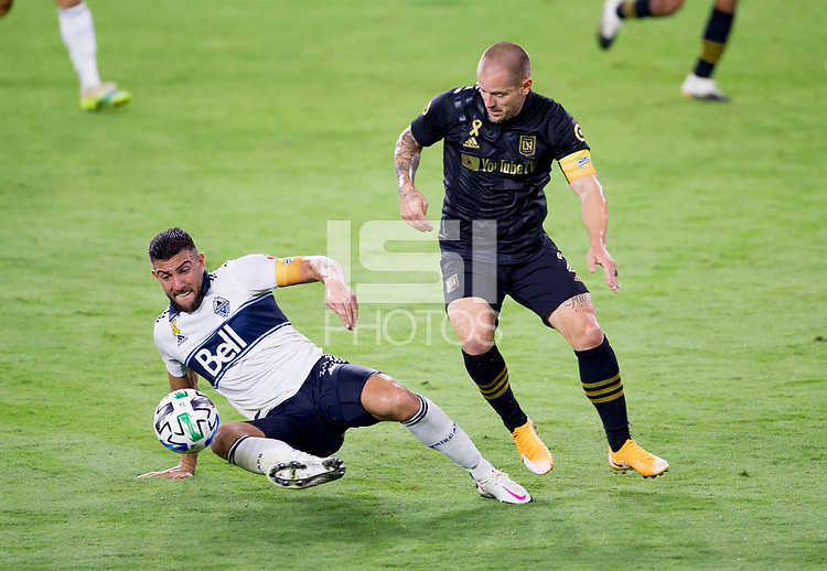 LOS ANGELES, CA - SEPTEMBER 23: Lucas Cavallini #9 of the Vancouver Whitecaps battles with Eduard Atuesta #20 of LAFC during a game between Vancouver Whitecaps and Los Angeles FC at Banc of California Stadium on September 23, 2020 in Los Angeles, California.