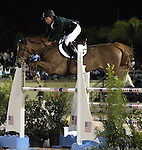 Darragh Kerins and Night Train compete for Ireland in the $75,000 FEI Nations Cup, an Olympics-style show jumping event, on Friday night, Feb. 28, 2009, during the Winter Equestrian festival in Wellington, Fla. Canada won the eight-nation, two-round competition before the first sellout (8,000) at the recently-renovated Palm Beach International Equestrian Center. Canada edged Ireland and Great Britain (tie) for the blue ribbons, followed by the United States. Also competing were teams from Argentina, France, Mexico and Venezuela. Thousands of cheering, flag-waving fans packed the International Arena at the WEF grounds for the Nations Cup, reportedly the oldest and most prestigious team show jumping competition in the world. Photo by Bob Markey II