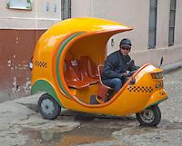 Cuba, Havana.  Coco-Taxi and Driver.
