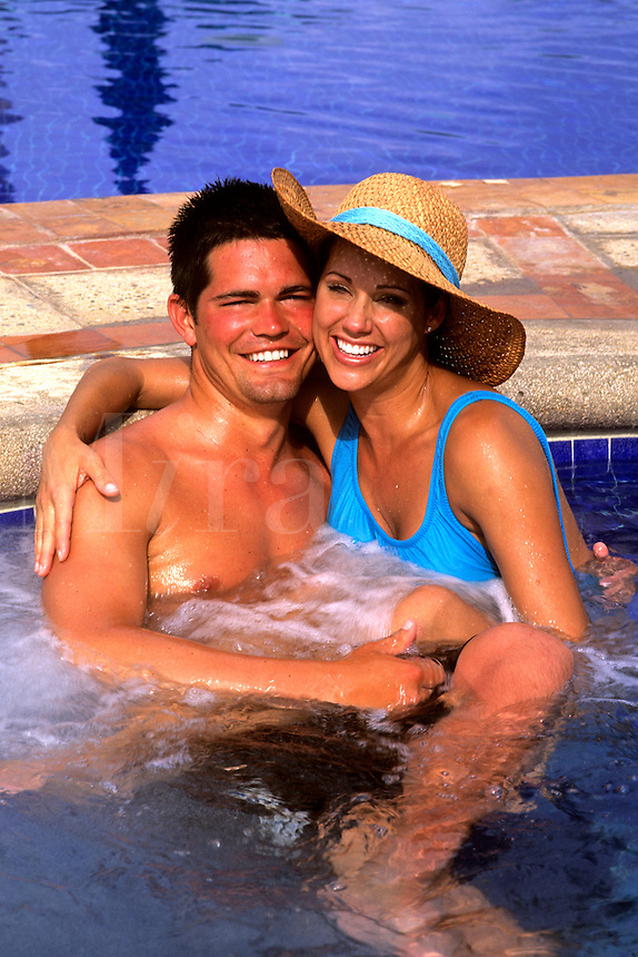 Romantic Hispanic couple in warm jacuzzi of Cancun Mexico